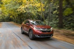 Picture of a driving 2019 Honda CR-V Touring AWD in Molten Lava Pearl from a front right perspective