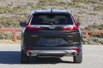 Picture of a 2019 Honda CR-V Touring AWD in Crystal Black Pearl from a rear perspective