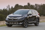 Picture of a 2019 Honda CR-V Touring AWD in Crystal Black Pearl from a front left perspective