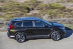 Picture of a driving 2019 Honda CR-V Touring AWD in Crystal Black Pearl from a right side perspective