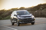 Picture of a driving 2019 Honda CR-V Touring AWD in Crystal Black Pearl from a front right perspective