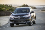 Picture of a driving 2019 Honda CR-V Touring AWD in Crystal Black Pearl from a front left perspective