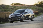 Picture of a driving 2019 Honda CR-V Touring AWD in Crystal Black Pearl from a front left three-quarter perspective