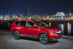 Picture of a 2019 Honda CR-V Touring AWD in Molten Lava Pearl from a front right perspective