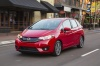 Driving 2017 Honda Fit in Milano Red from a front left view