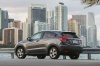 2017 Honda HR-V AWD in Modern Steel Metallic from a rear left three-quarter view