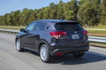 Picture of a driving 2018 Honda HR-V in Mulberry Metallic from a rear left perspective