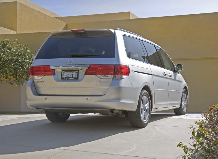 2010 Honda Odyssey in Alabaster Silver Metallic from a rear right view