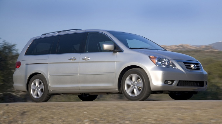 Driving 2010 Honda Odyssey in Alabaster Silver Metallic from a front right three-quarter view