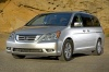 2010 Honda Odyssey in Alabaster Silver Metallic from a front left three-quarter view