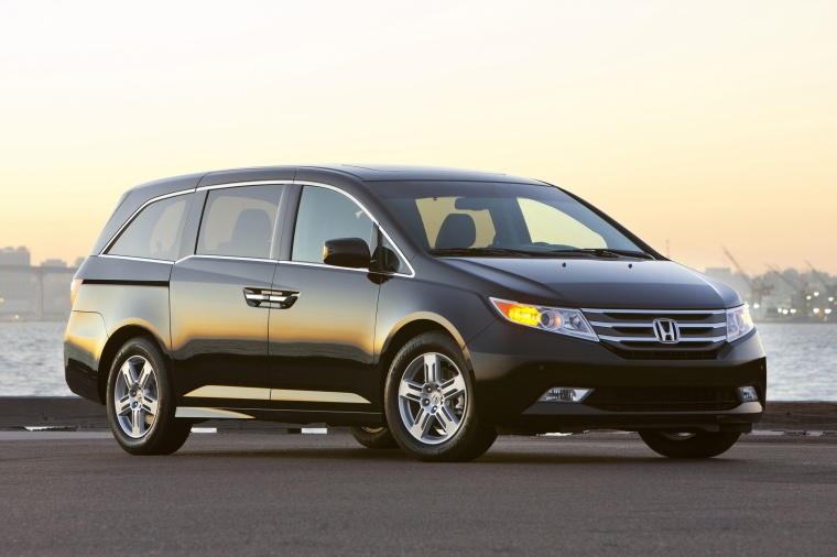2013 Honda Odyssey Touring in Crystal Black Pearl from a front right three-quarter view