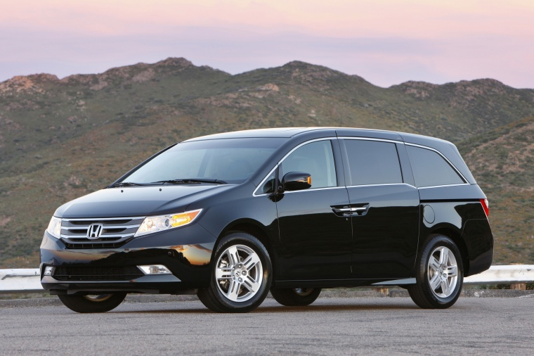 2013 Honda Odyssey Touring in Crystal Black Pearl from a front left three-quarter view