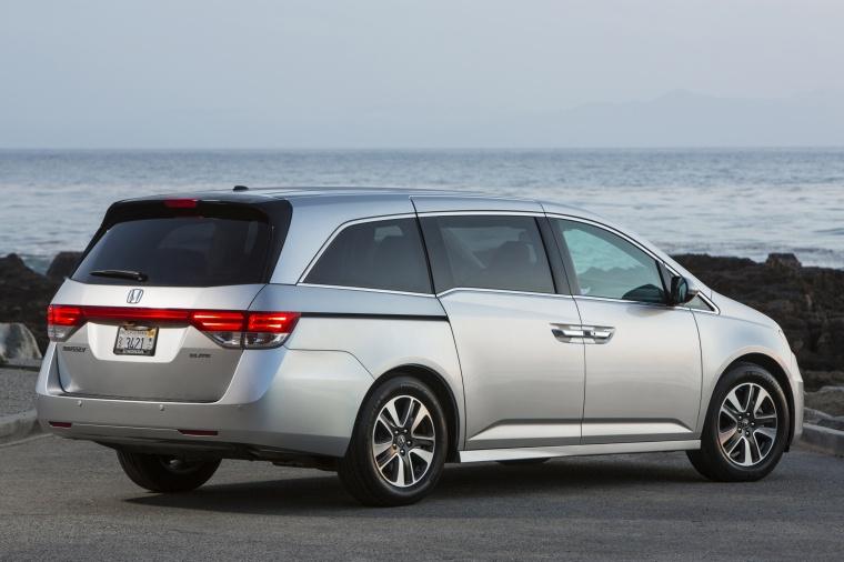2014 Honda Odyssey Touring Elite in Alabaster Silver Metallic from a rear right three-quarter view