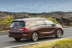 2018 Honda Odyssey Elite in Deep Scarlet Pearl - Driving Rear Right Three-quarter View