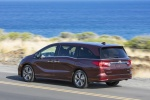 2018 Honda Odyssey Elite in Deep Scarlet Pearl - Driving Rear Left Three-quarter View