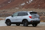 Picture of a 2020 Honda Passport Elite AWD in Lunar Silver Metallic from a rear left three-quarter perspective