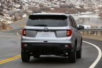 Picture of a driving 2020 Honda Passport Elite AWD in Lunar Silver Metallic from a rear right perspective