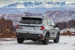 Picture of a driving 2020 Honda Passport Elite AWD in Lunar Silver Metallic from a rear right three-quarter perspective