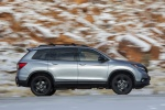 Picture of a driving 2020 Honda Passport Elite AWD in Lunar Silver Metallic from a right side perspective