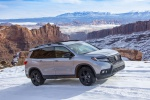 Picture of a driving 2020 Honda Passport Elite AWD in Lunar Silver Metallic from a front right three-quarter perspective