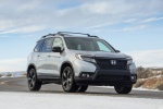 Picture of a driving 2020 Honda Passport Elite AWD in Lunar Silver Metallic from a front right perspective