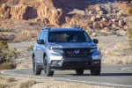 Picture of a driving 2020 Honda Passport Elite AWD in Lunar Silver Metallic from a frontal perspective