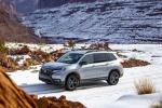 Picture of a driving 2020 Honda Passport Elite AWD in Lunar Silver Metallic from a front left three-quarter perspective