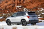 Picture of a driving 2020 Honda Passport Elite AWD in Lunar Silver Metallic from a rear left three-quarter perspective
