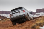 Picture of a driving 2020 Honda Passport Elite AWD in Lunar Silver Metallic from a rear perspective