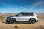Picture of a driving 2020 Honda Passport Elite AWD in Lunar Silver Metallic from a left side perspective