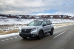 Picture of a driving 2020 Honda Passport Elite AWD in Lunar Silver Metallic from a front left perspective
