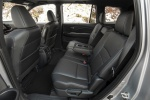 Picture of a 2020 Honda Passport Elite AWD's Rear Seats with Armrest Folded