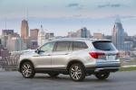 Picture of a 2016 Honda Pilot AWD in Lunar Silver Metallic from a rear left three-quarter perspective