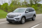Picture of a driving 2016 Honda Pilot AWD in Lunar Silver Metallic from a front left three-quarter perspective