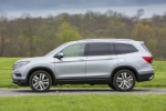 Picture of a driving 2016 Honda Pilot AWD in Lunar Silver Metallic from a side perspective