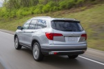 Picture of a driving 2016 Honda Pilot AWD in Lunar Silver Metallic from a rear left perspective