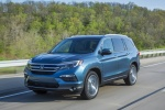 Picture of a driving 2016 Honda Pilot AWD in Steel Sapphire Metallic from a front left perspective
