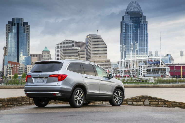 2017 Honda Pilot AWD in Lunar Silver Metallic from a rear right view