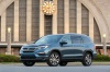 2017 Honda Pilot AWD in Steel Sapphire Metallic from a front left three-quarter view