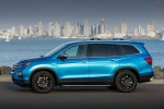 Picture of a 2017 Honda Pilot in Steel Sapphire Metallic from a side perspective