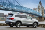 Picture of a 2017 Honda Pilot AWD in Lunar Silver Metallic from a rear right three-quarter perspective