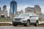 Picture of a 2017 Honda Pilot AWD in Lunar Silver Metallic from a front left perspective