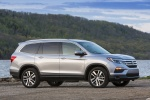 Picture of a 2017 Honda Pilot AWD in Lunar Silver Metallic from a front right three-quarter perspective