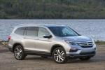 Picture of a 2017 Honda Pilot AWD in Lunar Silver Metallic from a front right perspective