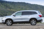 Picture of a 2017 Honda Pilot AWD in Lunar Silver Metallic from a side perspective