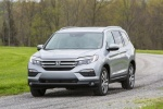 Picture of a driving 2017 Honda Pilot AWD in Lunar Silver Metallic from a front left perspective