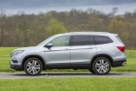 Picture of a driving 2017 Honda Pilot AWD in Lunar Silver Metallic from a side perspective
