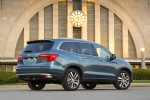 Picture of a 2017 Honda Pilot AWD in Steel Sapphire Metallic from a rear right three-quarter perspective