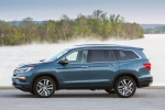 Picture of a 2017 Honda Pilot AWD in Steel Sapphire Metallic from a side perspective