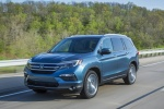 Picture of a driving 2017 Honda Pilot AWD in Steel Sapphire Metallic from a front left perspective